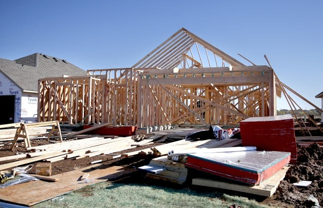 A home under construction by Home Creations, and in the framing stage, is shown on Brookline Drive near NW 197 in the Castleberry addition. [SARAH PHIPPS/THE OKLAHOMAN]