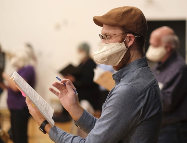 A Canterbury Voices singer wears his special singer mask during an Oct. 19 weekly rehearsal at the Joel Levine Rehearsal Room at the Civic Center. [Doug Hoke/The Oklahoman Archives]