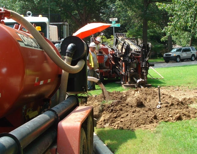 Crews work to create an underground pathway for an electrical distribution line in Tulsa. Undergrounded distribution lines must be buried 4 feet deep to protect the lines and people from potential mishaps. [PROVIDED BY PUBLIC SERVICE CO. OF OKLAHOMA]
