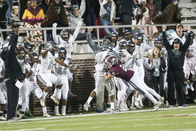 Edmond Santa Fe coaches and players celebrate while Talyn Shettron gets pushed out of bounds by Jenks' Branden Elrod after intercepting a pass in the Wolves win over Jenks last season. [IAN MAULE/TULSA WORLD]