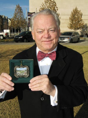 In this file photo, Mike McAuliffe shows an ornament sold to benefit the 2016 OKC Christmas Parade. [The Oklahoman Archives]