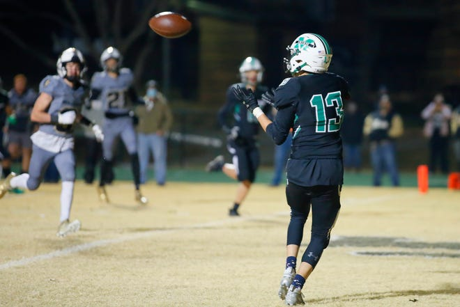 Cole Limber of Bishop McGuinness catches a touchdown pass to put Bishop McGuinness ahead in the final seconds of a high school football playoff game between Bishop McGuinness and McAlester at Bishop McGuinness in Oklahoma City, Friday, Dec. 4, 2020. [Bryan Terry/The Oklahoman]