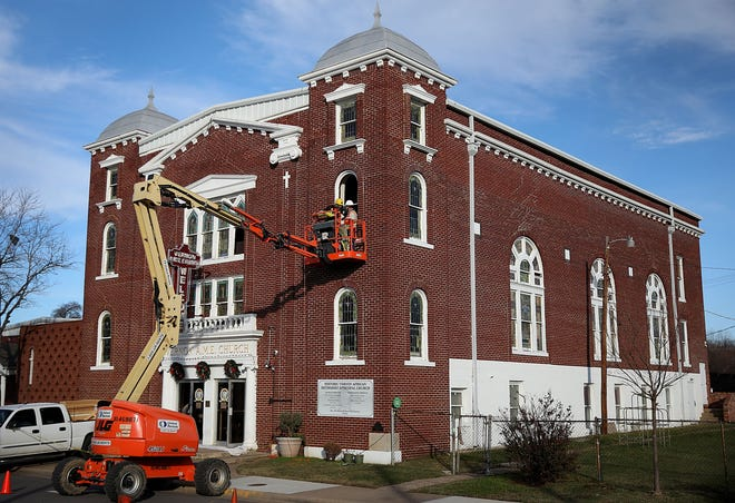 Workers remove stained glass windows from Vernon African Methodist Episcopal Church on Tuesday in Tulsa's Greenwood District. [Tulsa World]