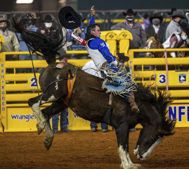 Richmond Champion competes in bareback during the opening night of the National Finals Rodeo in Arlington, Texas, on Thursday. [the associated press]