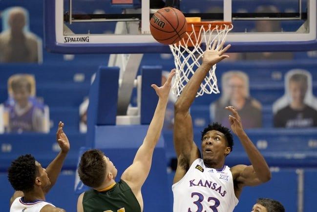 Kansas' David McCormack (33) blocks a shot by North Dakota State's Boden Skunberg (21) during Saturday's game in Lawrence, Kan. [AP Photo/Charlie Riedel]