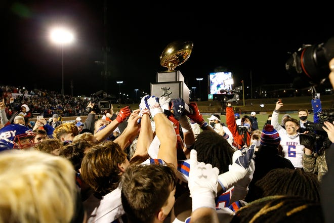 Bixby holds up the championship trophy after defeating Choctaw during the OSSAA Class 6A-II football title game at Wantland Stadium in Edmond, Okla. on Saturday, Dec. 5, 2020. Photo by Alonzo J. Adams for The Oklahoman.