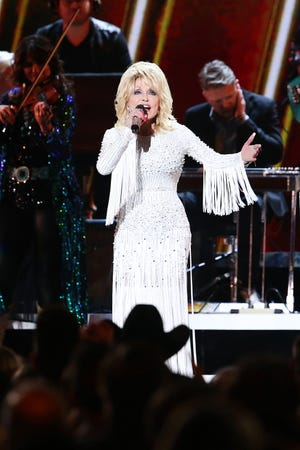 Dolly Parton performs onstage during the 53rd annual CMA Awards at the Bridgestone Arena on Nov. 13, 2019 in Nashville, Tennessee. [Terry Wyatt/Getty Images/TNS]