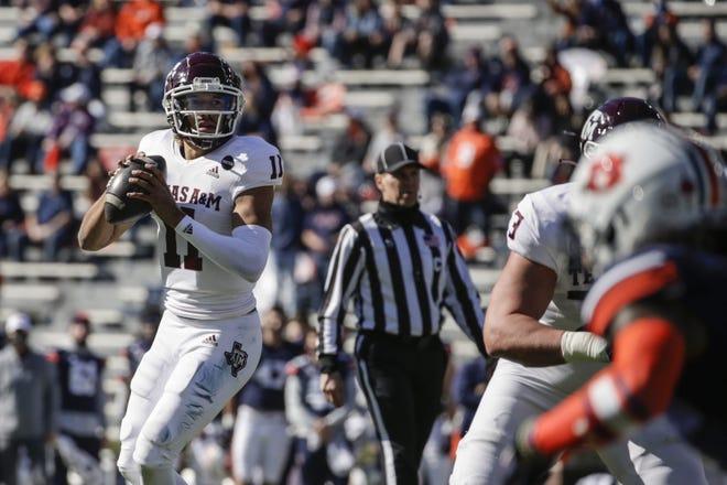 Texas A&M quarterback Kellen Mond (11) looks to pass against Auburn during Saturday's game in Auburn, Ala. [AP Photo/Butch Dill]