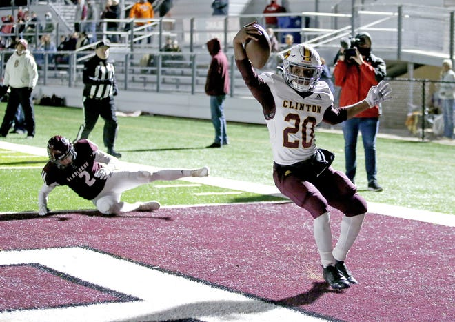 Clinton's Artrel Bryson scores a touchdown in front of Blanchard's Whit Carpenter during a 10-7 win Friday in a Class 4A semifinal in Blanchard. [Sarah Phipps/The Oklahoman]
