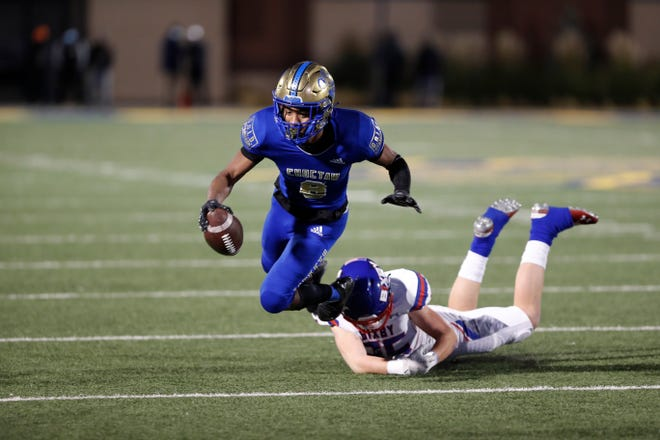 ChoctawÕs Terrill Davis (8) is tackled from behind by BixbyÕs Beau Bertelli (35) during the OSSAA Class 6A-II football title game at Wantland Stadium in Edmond, Okla. on Saturday, Dec. 5, 2020. Photo by Alonzo J. Adams for The Oklahoman.