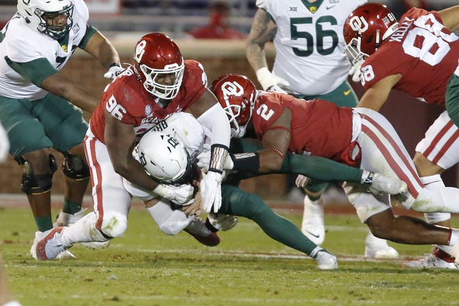 OU's LaRon Stokes (96) and David Ugwoegbu (2) bring down Baylor's Charlie Brewer (5) during the Sooners' 27-14 win Saturday in Norman. [Bryan Terry/The Oklahoman]