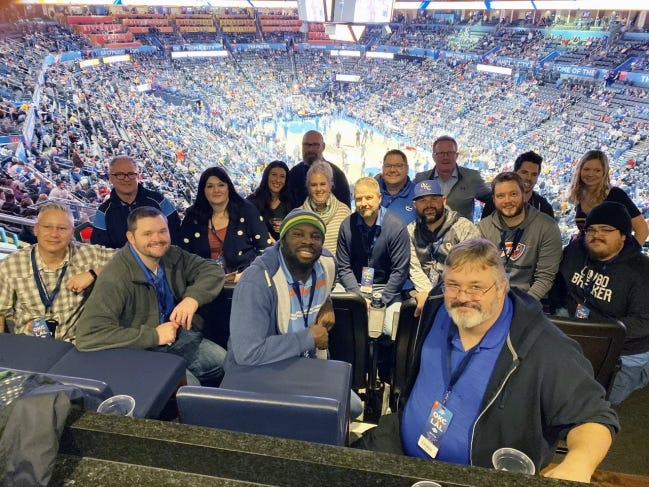 MY Consulting Group employees cheer on the Thunder. [SUBMITTED PHOTO]