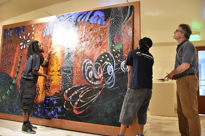 Workers move artwork out of the Betty Price Gallery in June 2019 during the restoration of the state Capitol. The gallery is being moved to a new home in the Capitol. [Photo provided]