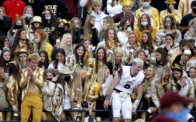 Jenks' Stephen Kittleman celebrates with fans following the Class 6A-1 state championship high school football game between Edmond Santa Fe and Jenks at Wantland Stadium in Edmond, Okla., Saturday, Dec. 5, 2020. [Sarah Phipps/The Oklahoman]