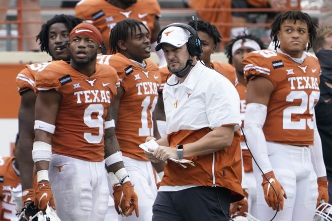Coach Tom Herman, center, is 31-18 in four seasons at UT. He's got a 3-0 bowl record but has not won a Big 12 title, played for only one so far (2018) and gone 1-4 against rival Oklahoma. [AP Photo/Eric Gay, File]