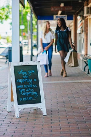 Shoppers can help boost Edmond's businesses during a holiday gift card rebate program that continues through Saturday. [PHOTO PROVIDED]
