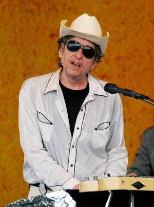 Bob Dylan performs during the 2006 New Orleans Jazz and Heritage Festival in New Orleans on April 28, 2006. [AP Photo/Jeff Christensen, File]