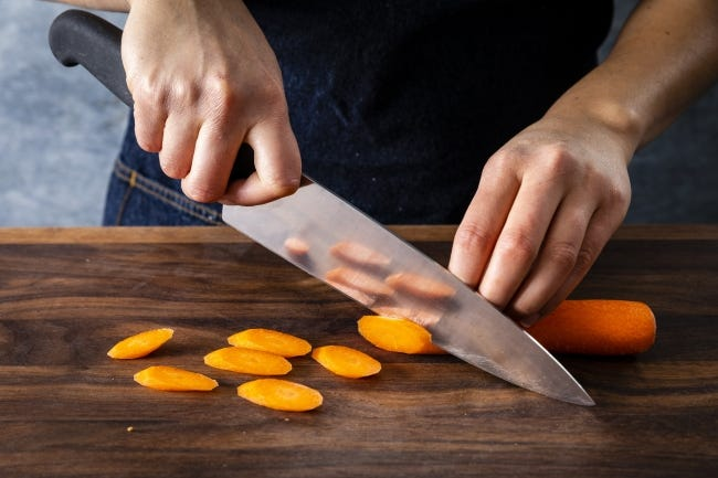 The best chef's knife for you is the one that feels right. Hold the knife before you buy it. If possible, ask if you can use it to cut something, like a carrot. [PHOTO PROVIDED/AMERICA'S TEST KITCHEN]