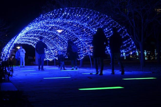 Families enjoy Holiday Lights, a display throughout the Myriad Botanical Gardens, in Oklahoma City on Monday. [Doug Hoke/The Oklahoman]