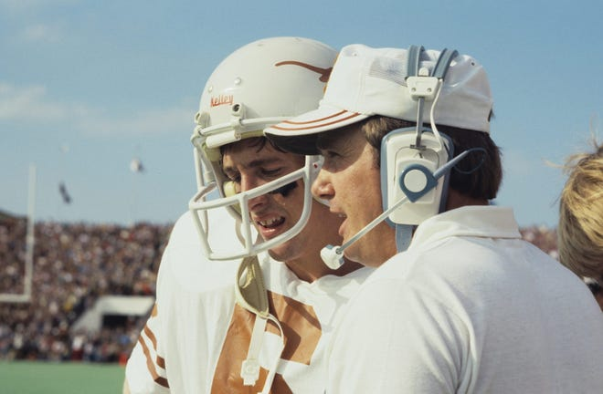 Former Texas football coach Fred Akers, shown with quarterback Randy McEachern during a game, had a highly successful run for 10 years in Austin. But players remembered the coach who died on Monday as a great leader who made a huge impact on UT's football program. [PHOTO COURTESY OF UT ATHLETICS]