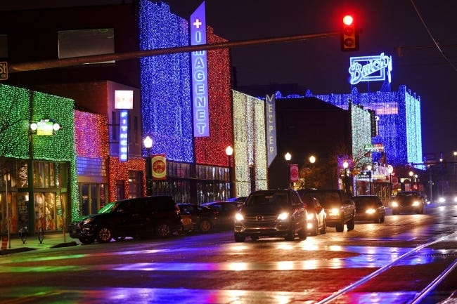 Automobile Alley's distinctive draped holiday lights gleam Tuesday, November 24, 2020. The historic downtown OKC district dazzles this time of year, with more than 230,000 kaleidoscopic LED lights curtaining the buildings along 10 blocks of North Broadway and the side streets through Jan. 10. [Doug Hoke/The Oklahoman Archives]