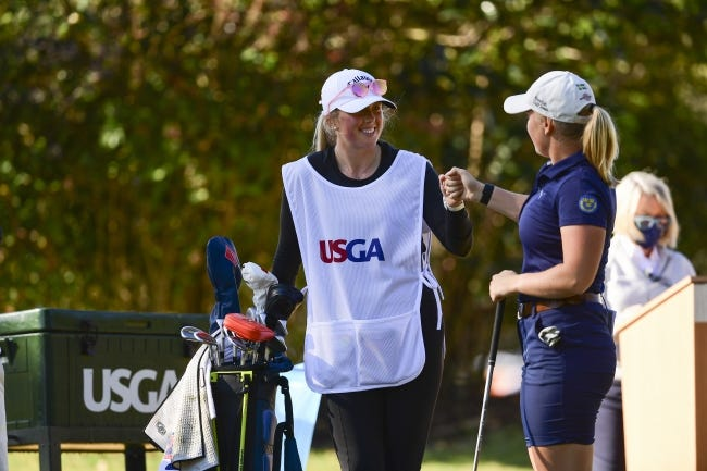 Oklahoma State golfer Maja Stark, right, and caddie Emma Whitaker fist-bump prior to teeing off on the 10th hole during the first round at the U.S. Women's Open in Houston on Thursday. [Robert Beck/USGA]