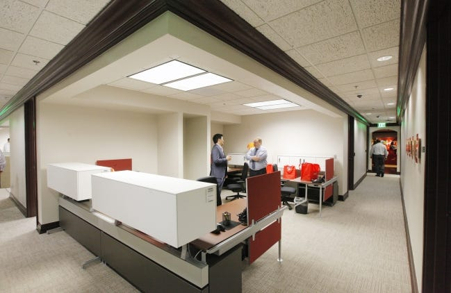 """""""Hoteling,"""" unassigned seating for flexibility in the office workplace, isn't new, but it is among trends accelerating as office space and practices respond to the coronavirus. PwC, formerly PricewaterhouseCoopers, included this hoteling section for employees at its office at Leadership Square downtown when it opened in 2014. [THE OKLAHOMAN ARCHIVES]"""