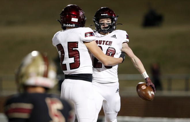 Holland HallÕs Brenden Terry (28) and Braxton Utter (25) celebrate a touchdown against Lincoln Christian during the OSSAA Class 3A football championship game at Wantland Stadium in Edmond, Okla. on Friday, Dec. 11, 2020. Photo by Alonzo J. Adams for The Oklahoman.