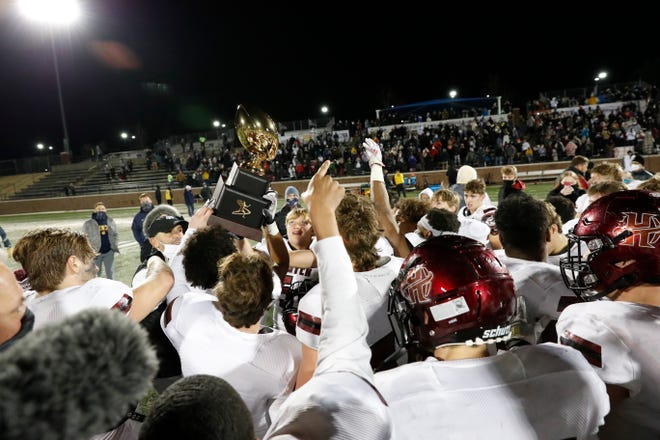 Holland Hall holds up the championship trophy after defeating Lincoln Christian during the OSSAA Class 3A football championship game at Wantland Stadium in Edmond, Okla. on Friday, Dec. 11, 2020. Photo by Alonzo J. Adams for The Oklahoman.