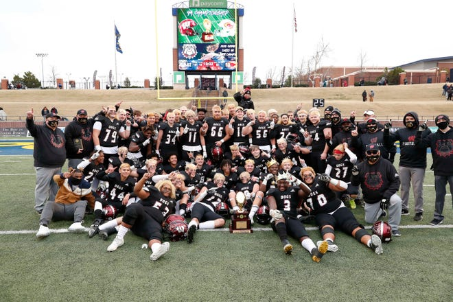 Wagoner poses for a picture with the championship trophy after defeating Clinton during the OSSAA Class 4A football championship game at Wantland Stadium in Edmond, Okla. on Saturday, Dec. 12, 2020. Photo by Alonzo J. Adams for The Oklahoman.