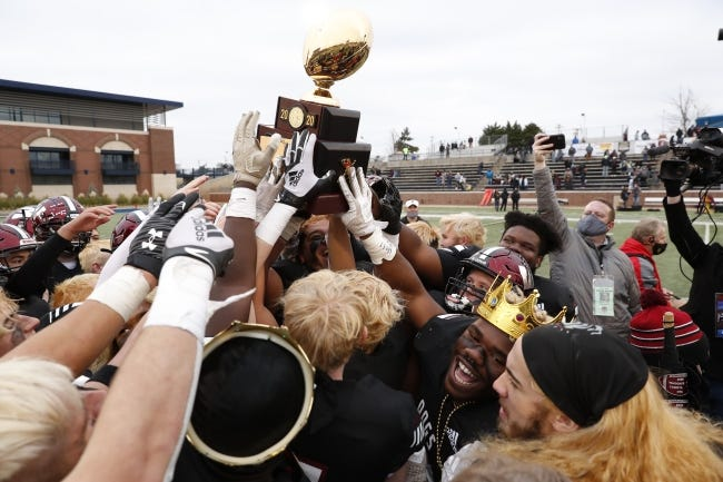 Wagoner holds up the championship trophy after defeating Clinton during the OSSAA Class 4A football championship game at Wantland Stadium in Edmond, Okla. on Saturday, Dec. 12, 2020. Photo by Alonzo J. Adams for The Oklahoman.