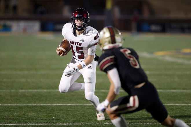 Holland HallÕs Wallace Clark (15) runs for a first down as Lincoln ChristianÕs Jordan Marsh (5) closes in for a stop during the OSSAA Class 3A football championship game at Wantland Stadium in Edmond, Okla. on Friday, Dec. 11, 2020. Photo by Alonzo J. Adams for The Oklahoman.