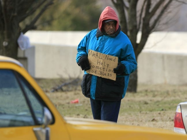 A man asks for handouts at Memorial Road and May Avenue on Jan. 6, 2016, the last day before a city ordinance made panhandling on the medians in Oklahoma City illegal. The city council voted 5-4 Tuesday to ask the U.S. Supreme Court to review the controversial ordinance, which was struck down by a three-judge panel of the 10th U.S. Circuit Court of Appeals in Denver. [The Oklahoman Archives]