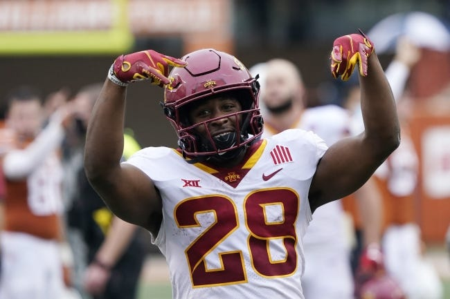 Iowa State running back Breece Hall has been the top offensive player in the Big 12 this season, with a FBS-best 1,357 rushing yards, scoring 17 times. [AP Photo/Eric Gay]
