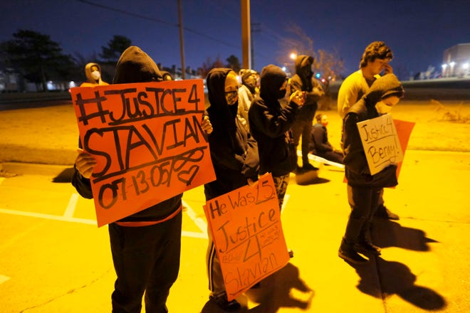 People meet to protest the killing of Bennie Edwards and Stavian Rodriguez recently by the Oklahoma City Police, to march to and hold a rally at the Hefner Division Police Station, Saturday, December 12, 2020. [Doug Hoke/The Oklahoman]
