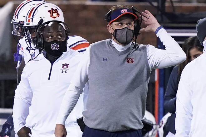 Auburn head coach Gus Malzahn listens to an official's call during the second half against Mississippi State. Malzahn was bought out after 8 seasons with the Tigers. [AP Photo/Rogelio V. Solis]