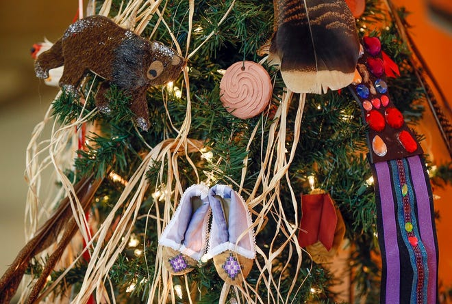 Ornaments adorn the Caddo (Hasinai) Nation Christmas Tree at the 2019 Red Earth Treefest at the OSU-OKC Student Center in Oklahoma City, Monday, Dec. 2, 2019. [The Oklahoman Archives]