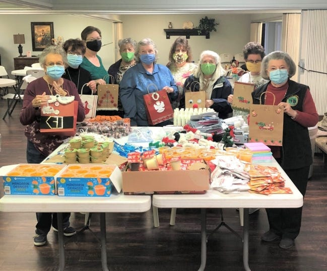 Friendship OHCE members, pictured from left, Regina Evans, Margaret Barbour, Valarie Alcorn, Bernie Calvert, Judy Albertson, April Green, Jody Robinson, Debbie Reese and Martha Aughe filled handmade Christmas bags for the Noble Nursing Home. [PHOTO PROVIDED]