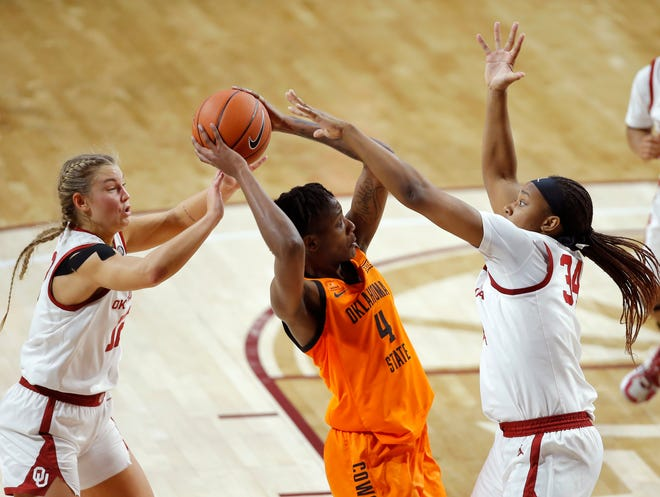 Oklahoma's Gabby Gregory (12) and Liz Scott (34) defend Oklahoma State's Natasha Mack (4) during a Bedlam women's college basketball game between the University of Oklahoma (OU) and Oklahoma State University (OSU) at Lloyd Noble Center in Norman, Okla., Tuesday, Dec. 15, 2020. [Bryan Terry/The Oklahoman]