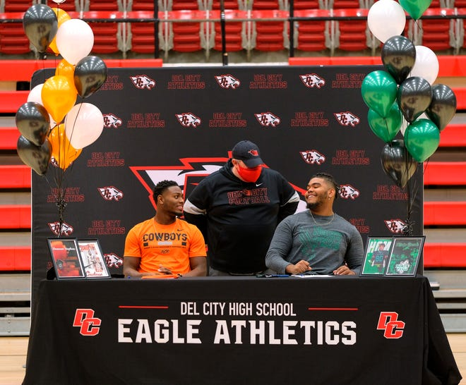 Del City's signing day ceremony. DC coach Mike Dunn with Donovan Stephens is signing with Oklahoma State and Kevin Greene signing with North Texas Thursday, December 17, 2020. [Doug Hoke/The Oklahoman]
