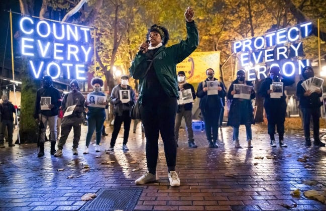 """A """"Count Every Vote - Protect Every Person"""" rally and march in Seattle on Nov. 4. [AP Photo]"""