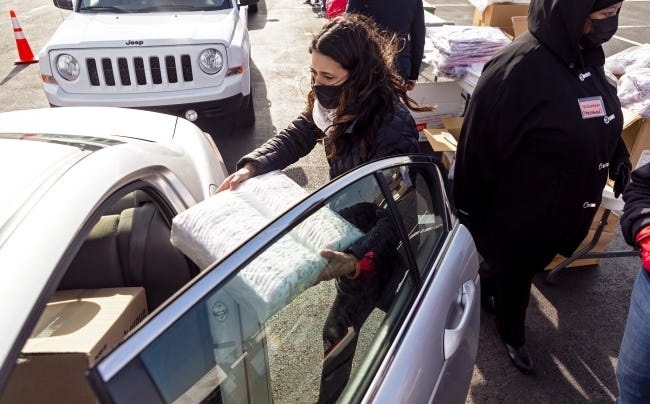 """U.S. Representative-elect Stephanie Bice helps to pass out food boxes and other essentials to motorists on Dec. 11 during the """"Simultaneous Free Food Box Giveaway"""" at Ebenezer Baptist Church. [Chris Landsberger/The Oklahoman]"""
