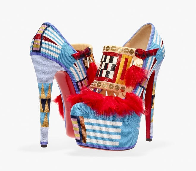 """Jamie Okuma's (Luiseño/Shoshone-Bannock, born 1977), """"Adaption II"""" are high-heel shoes designed by Christian Louboutin and adorned by the artist with feathers, glass beads, porcupine quills, sterling silver cones, brass sequins, chicken feathers, cloth, deer rawhide and buckskin. The shoes are included in the exhibit """"Hearts of Our People: Native Women Artists,"""" on view through Jan. 3 at the Philbrook Museum of Art in Tulsa. [Photo provided]"""