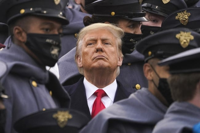 Surrounded by Army cadets, President Donald Trump watches the first half of the Army-Navy football game on Saturday, Dec. 12. [AP Photo/Andrew Harnik]