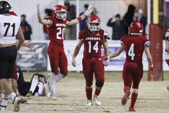 Washington's Jadon Sanchez (14), Jaxon Sanchez (4) and Hayden Milner (20) celebrate during their Class 2A semifinal win over Beggs on Dec. 11. [Bryan Terry/The Oklahoman]