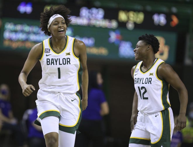 Baylor forward NaLyssa Smith, left, reacts to her score against Northwestern with teammate guard Moon Ursin, right, during Friday's game in Waco, Texas. The Lady Bears won for the 60th straight time at home. [Rod Aydelotte/Waco Tribune-Herald via AP]