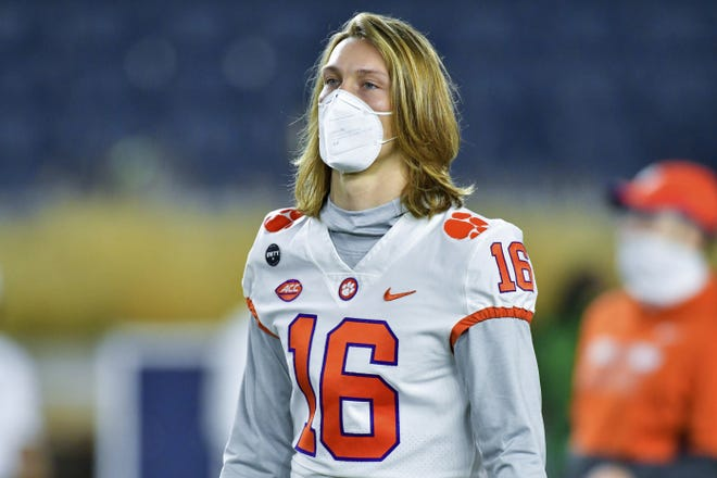Clemson quarterback Trevor Lawrence watches players warm up for a game against Notre Dame. The Notre Dame Fighting Irish beat the Clemson Tigers in a thrilling 47-40 shootout earlier this season. The big question now is if they can do it again against likely No. 1 overall 2021 NFL draft pick Trevor Lawrence in the Atlantic Coast Conference championship game. [Matt Cashore/Pool Photo via AP, File]
