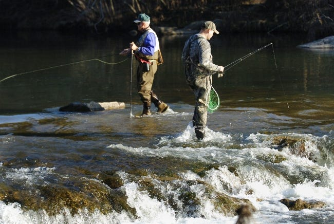 Trout fishermen try their luck at the Blue River near Tishomingo, one of the six designated winter trout fishing areas managed by the Oklahoma Department of Wildlife Conservation. [THE OKLAHOMAN ARCHIVES]