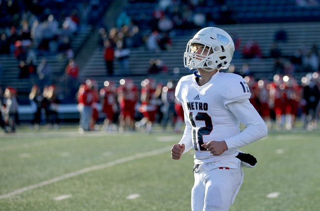Metro Christian quarterback Kirk Francis runs off the field after a touchdown during the Class 2A state championship game between Washington and Metro Christian at Wantland Stadium in Edmond, Okla., Saturday, Dec. 19, 2020. [Sarah Phipps/The Oklahoman]