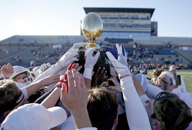 Metro Christian celebrates the 2A during the Class 2A state championship football game over Washington at Wantland Stadium in Edmond, Okla., Saturday, Dec. 19, 2020. [Sarah Phipps/The Oklahoman]